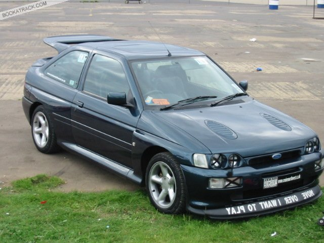 1st thought was Escort RS Cosworth Ford Escort Cosworth, released in 92